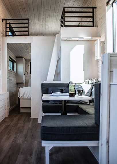 Interior of a Dune cabin with a view of the modern, spacious dinette area and loft space.